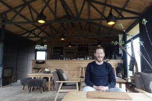 Scott Mallinson, web designer, developer and digital specialist, sat in a restaurant in Gansu province