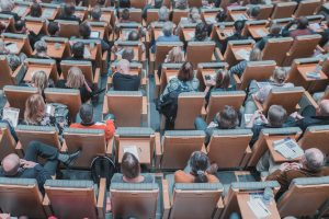 People in an auditorium. Photo by Mikael Kristenson on Unsplash. Photo by Mikael Kristenson on Unsplash